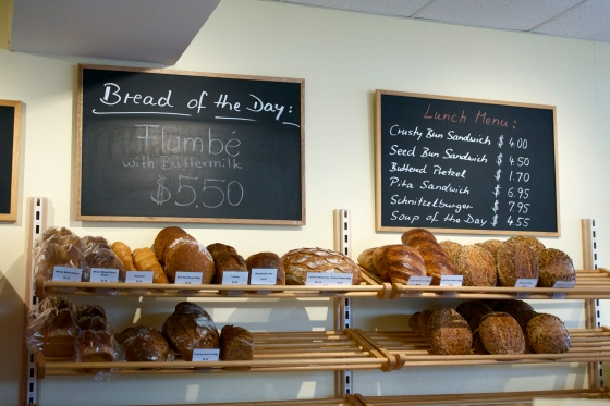 Selection of specialty breads for sale and lunch menu